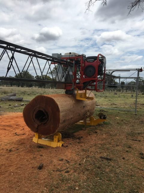 Goodwood Mobile Sawmill and Log Rotator cutting split posts